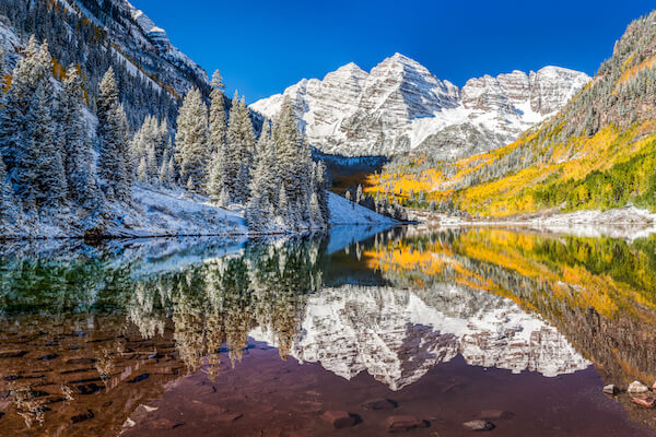 Rocky Mountains, Lake and wilderness, snow covered peaks