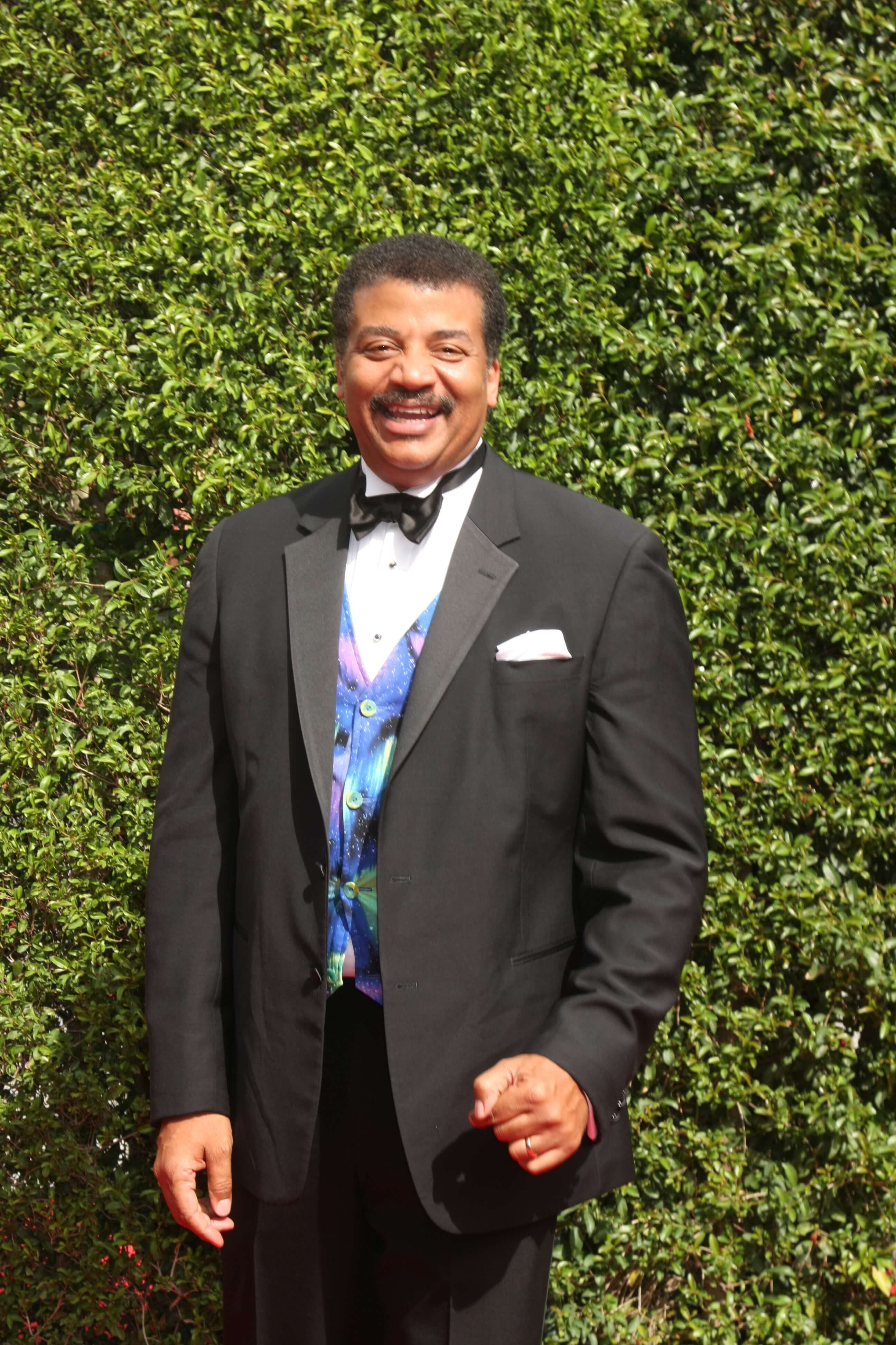 Neil deGrasse Tyson, Neil deGrasse Tyson in a suite., Neil deGrasse Tyson at an award show