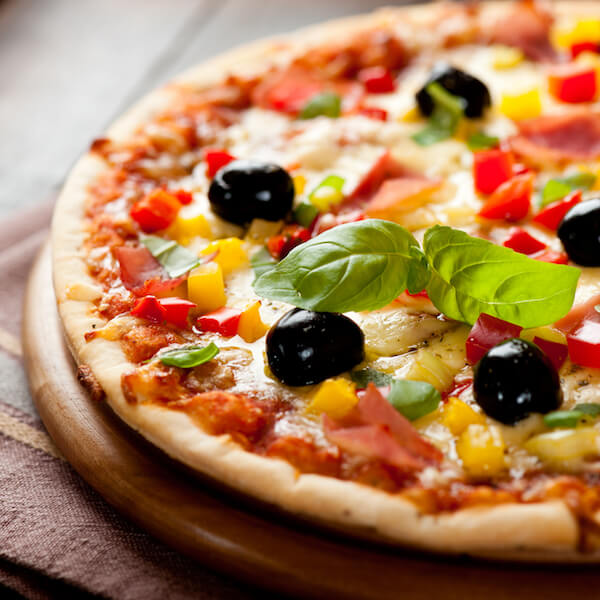 PIzza with all the toppings, pizza with olives and peppers