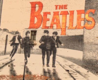 mural of the Beatles painted in a brick wall