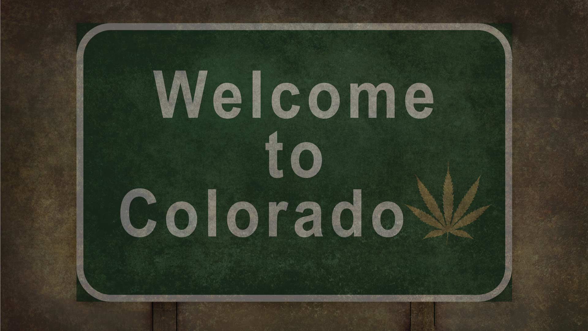 Welcome to Colorado sign with a pot leaf