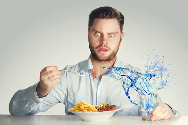 Man hallucinating while eating