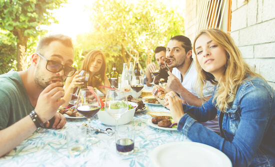 People eating BBQ at a table