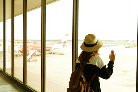 Woman watching planes