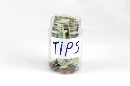 tip jar full of money, jar for tipping