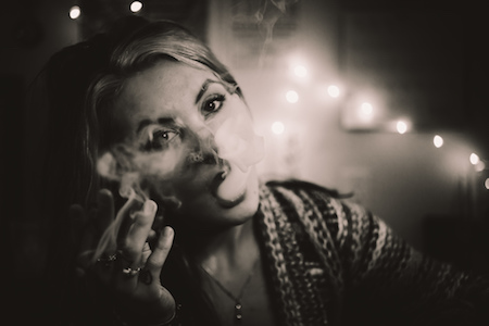 woman smoking cannabis, legalization of cannabis