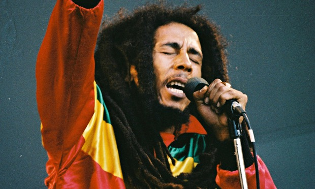 Bob Marley performing live on stage.