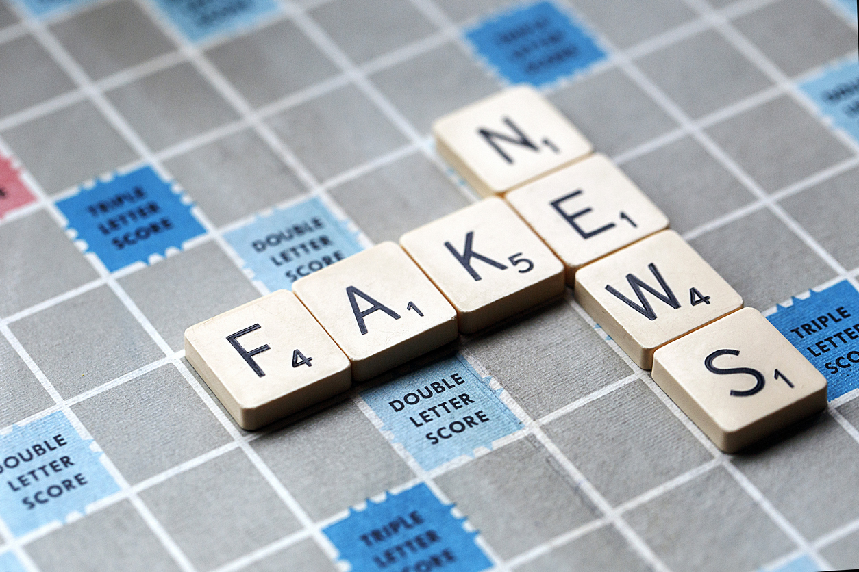 London, UK: January 31, 2017: A Scrabble game board with the letters forming the words 'Fake News'. Scrabble is a fun and educational game distributed worldwide by Hasbro.