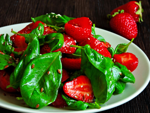 Strawberry and spinach leaf salad is a healthy summer dish