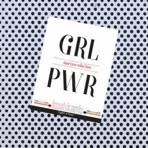 "Paper that reads ""girl power."""