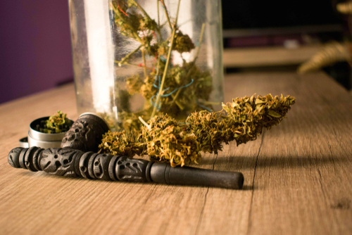 cannabis with a pipe and a grinder