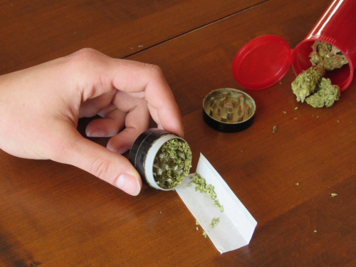 Rolling joint with weed and grinder