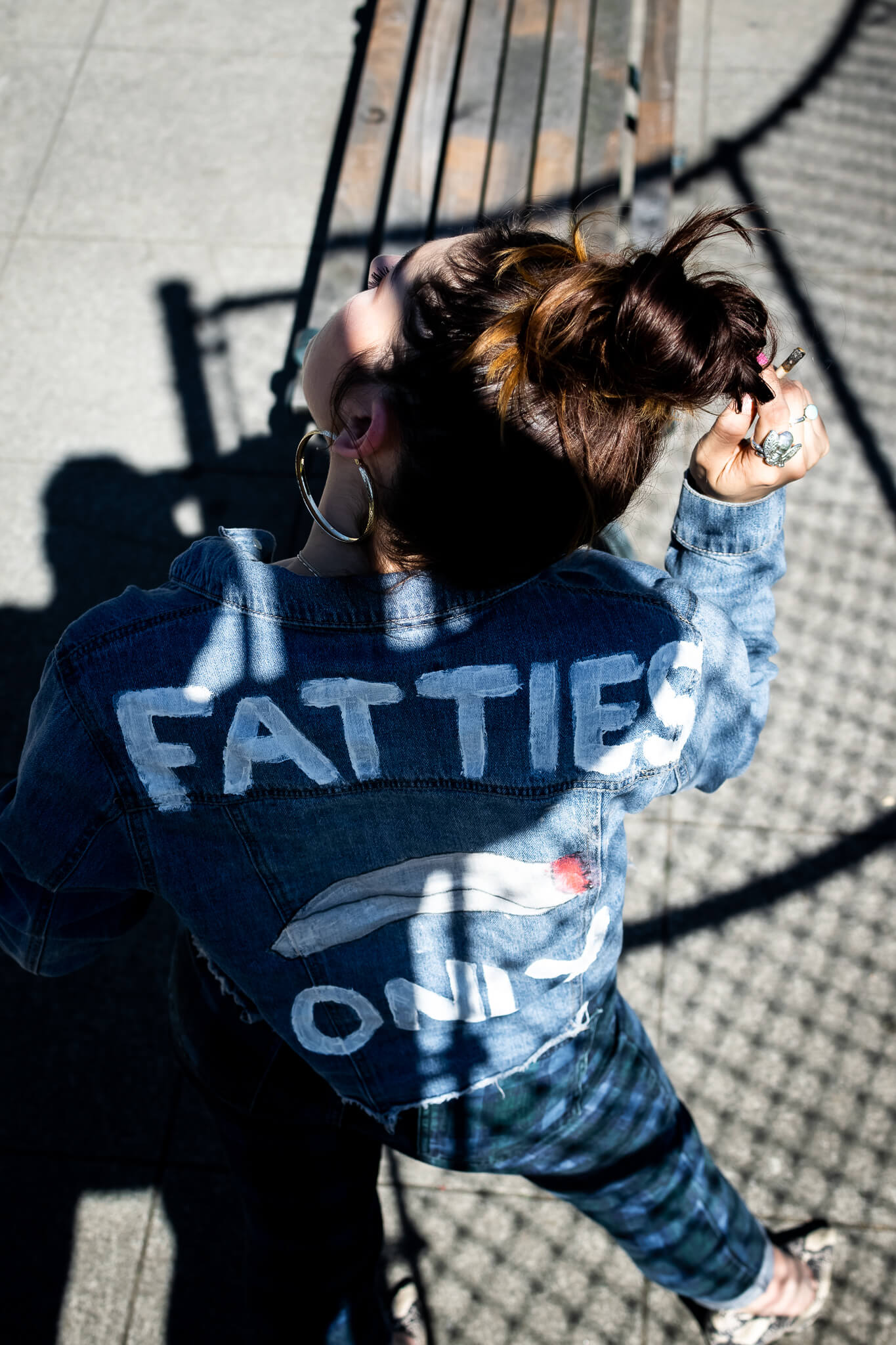 "Onjha from Saints with a jean jacket that reads, ""Fatties Only."""