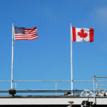 Flags flying at the US Canada Border