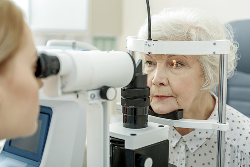 Older woman getting an eye exam