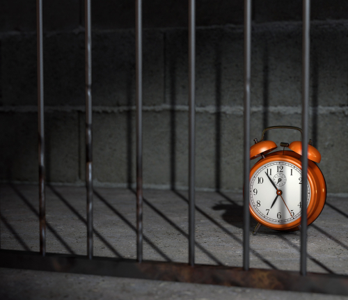 Orange clock in a jail cell