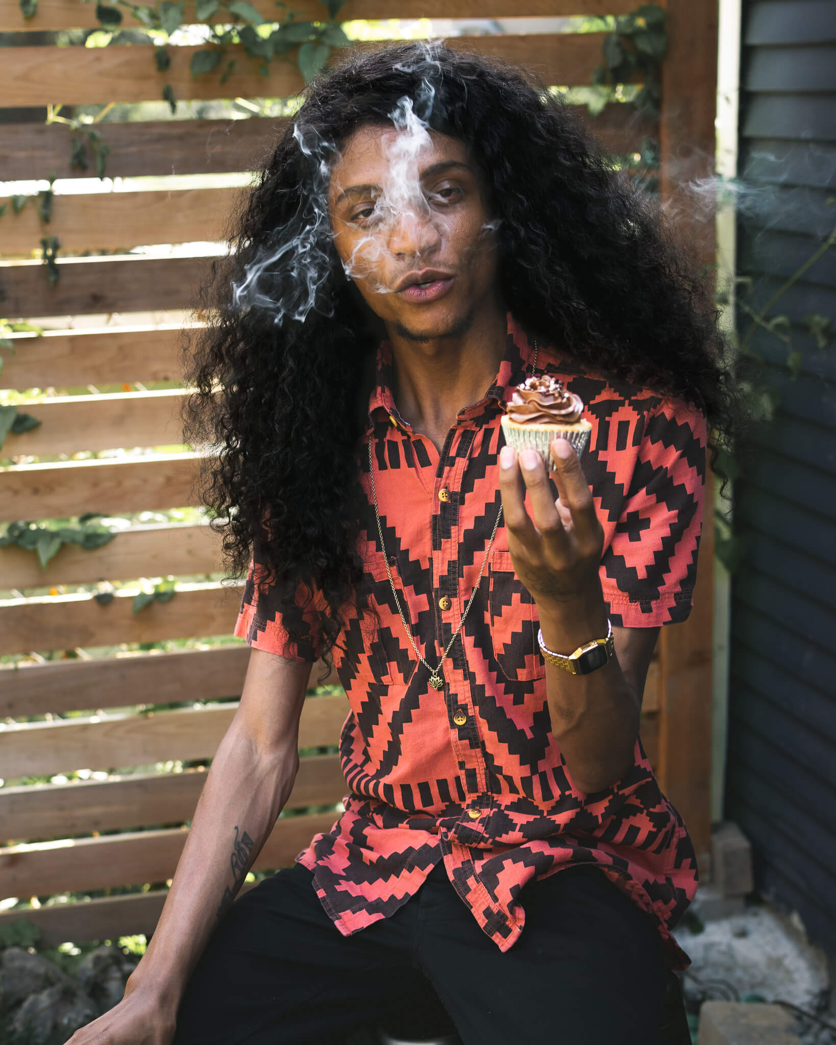 Dominique Dabs eating a cupcake and smoking a blunt