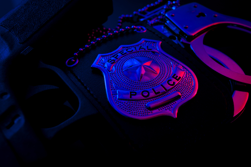 Police badge at night