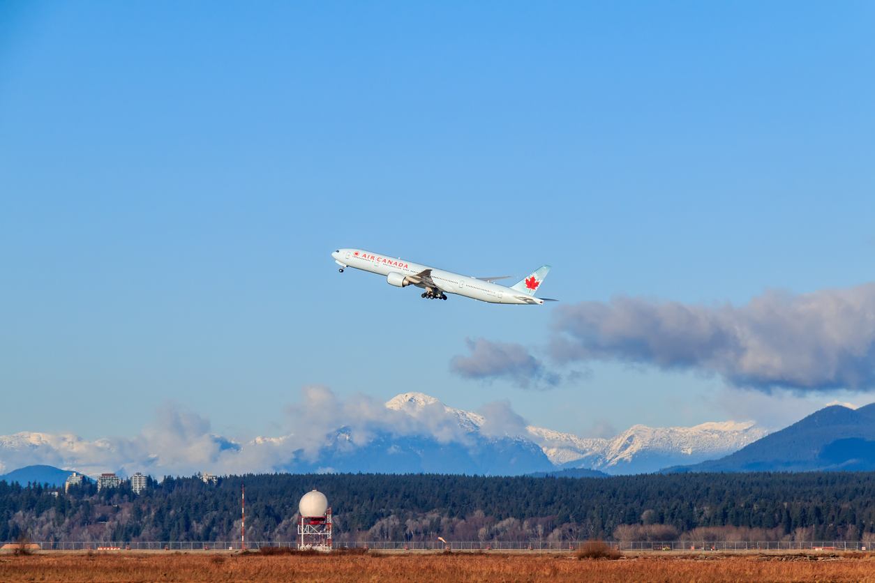 Vancouver, Canada - January 3, 2014: Air Canada airplane takes off in Vancouver International Airport at January 3, 2014. Air Canada is the largest airline company in Canada.