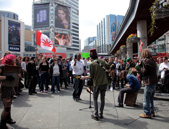 Toronto, Canada - April 20, 2012: A music band plays at a 420 Marijuana Rally at Yonge Dundas Square, legal cannabis