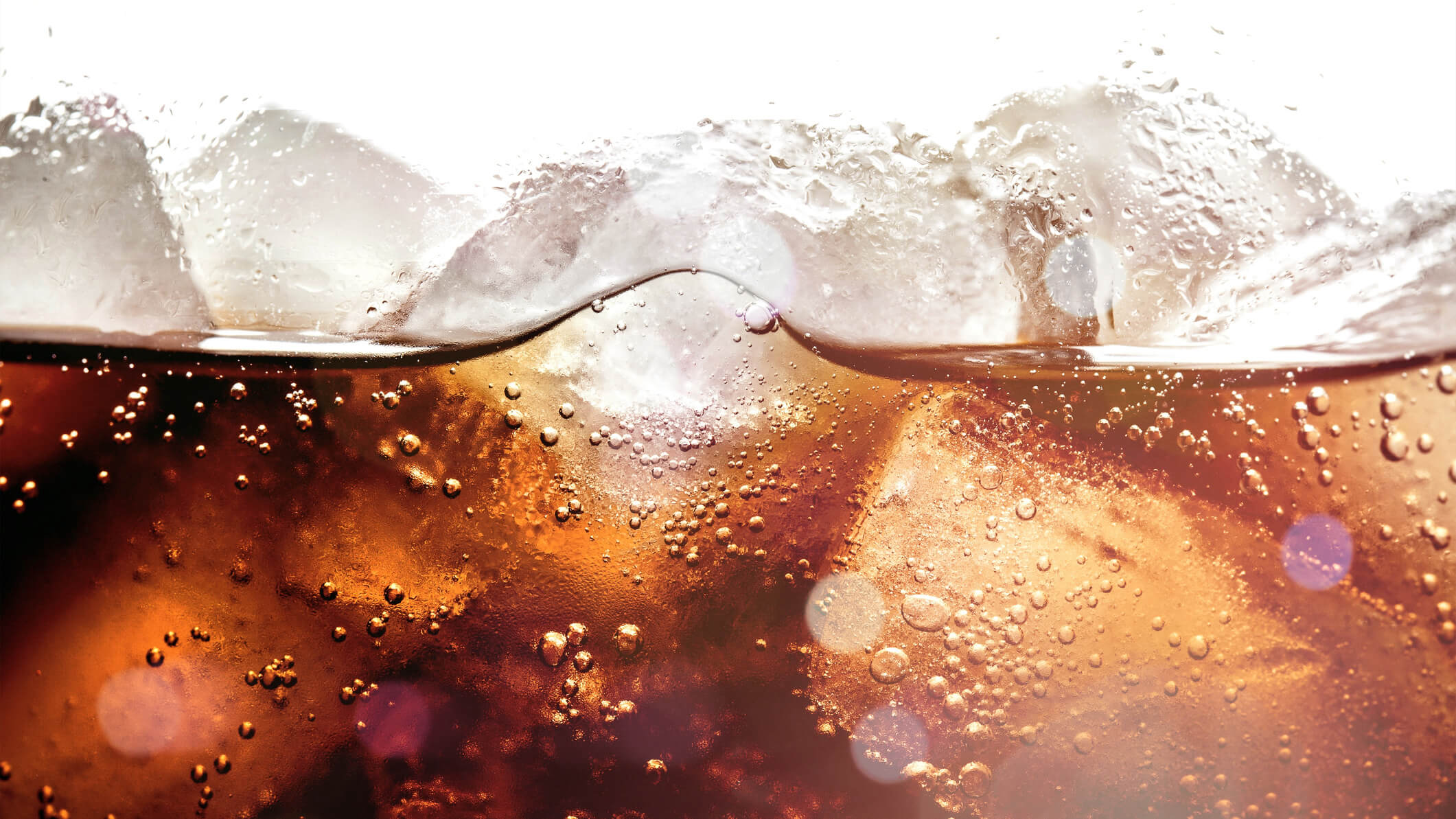 Ice cubes in cola beverage, close up