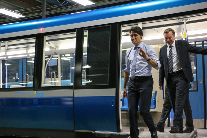 Montreal, Canada - April 6, 2016: PM Justin Trudeau and Philippe Schnobb, chairman of the board at the STM (Societe de transport de Montreal), get out of the new Azur train for a visit of the public transit installations.