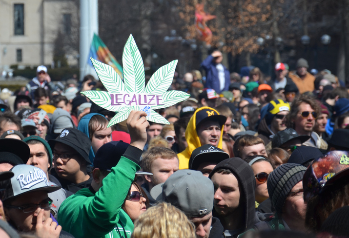 Ann Arbor, MI, USA - April 5, 2014: A participant holds up a sign at the 43rd annual Hash Bash rally in Ann Arbor, MI April 5, 2014.
