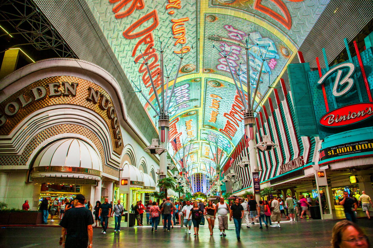 Las vegas, USA - June 16, 2012: people visit Fremont Street in Las Vegas, Nevada . The street is the second most famous street in the Las Vegas. Fremont Street dates back to 1905, when Las Vegas was founded.