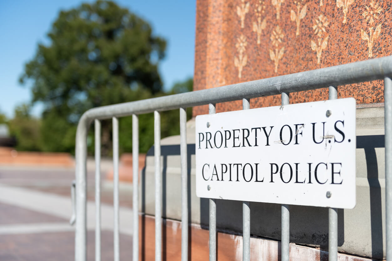 Washington DC, USA security by US Congress in capital city closeup isolated on fence railing with property of capitol police sign