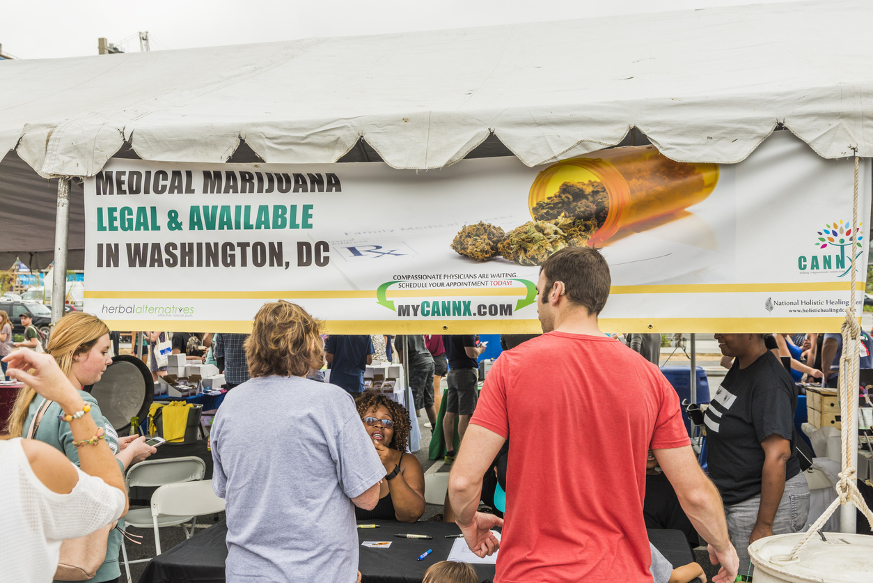 Washington DC, USA - September 24, 2016: Cannx Medical marijuana booth and sign at VegFest vegan vegetarian festival with people