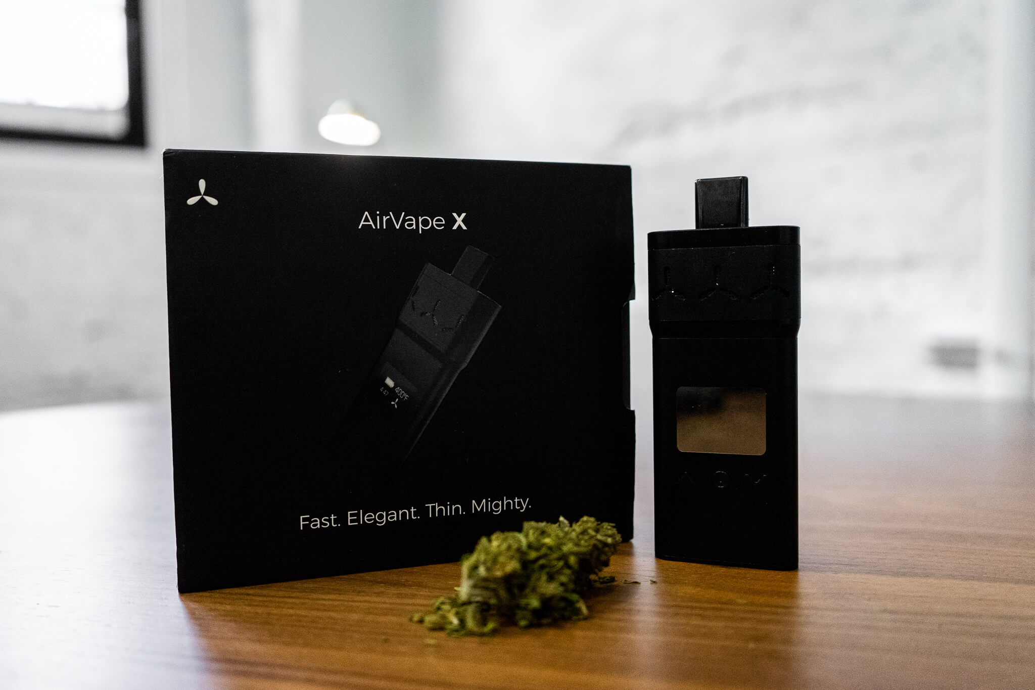 AirVape X next to the box
