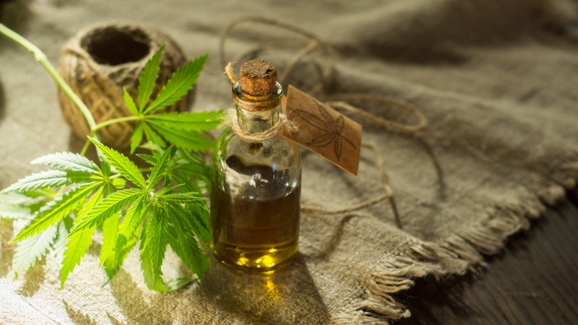 weed tincture on woven table cloth.