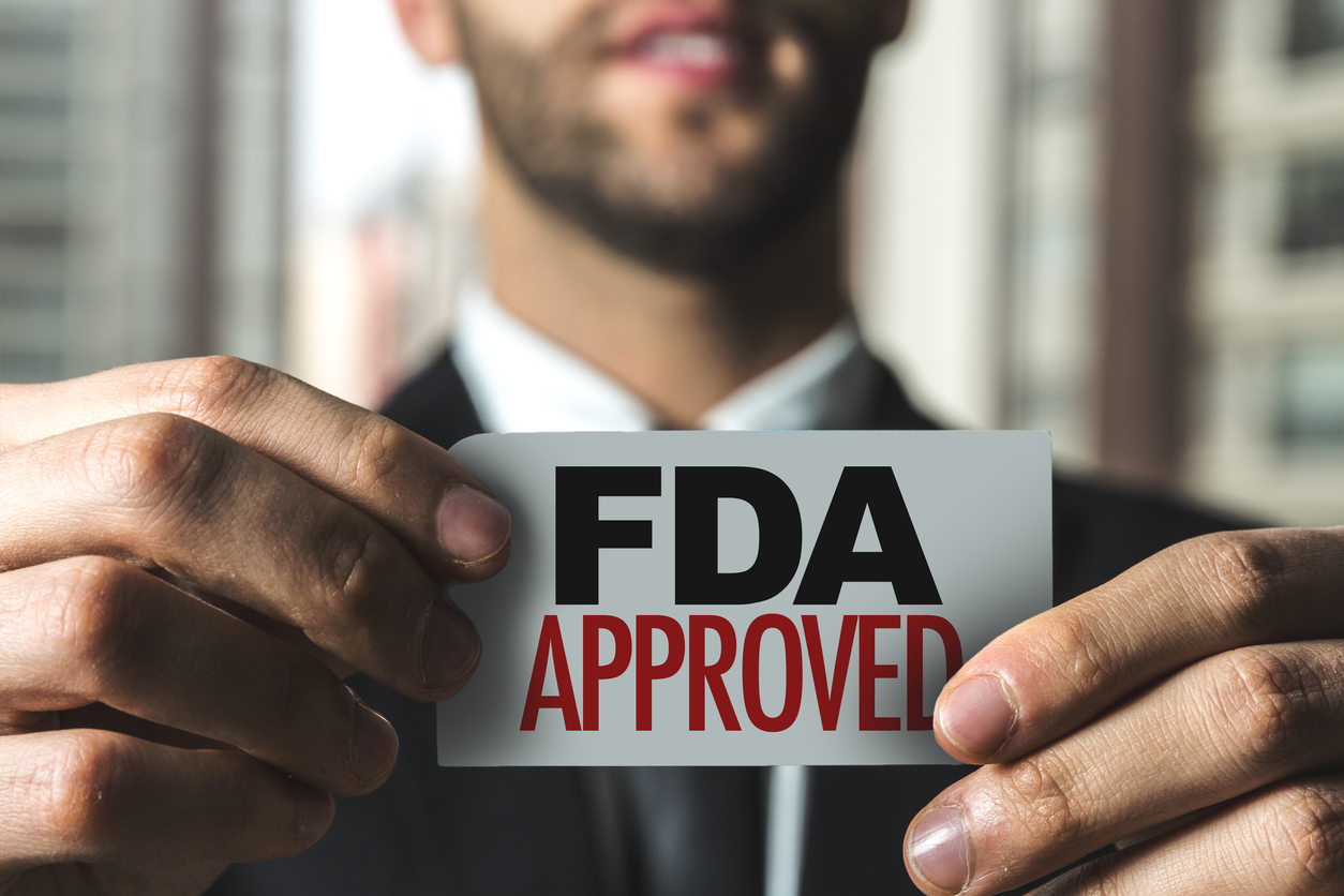 Man holding sign that says FDA approved