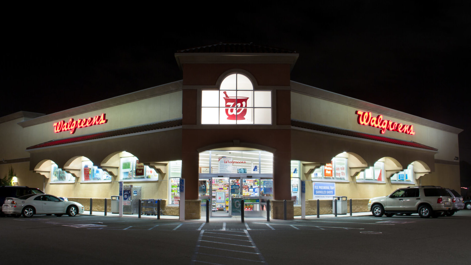 Walgreens store and parking lot at night.
