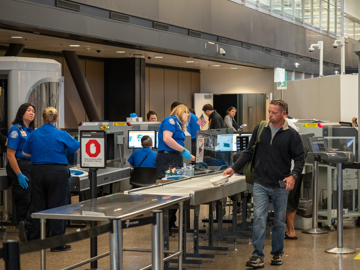 Seattle, WA AUGUST 26, 2018: Man passes though Transportation Security Administration TSA security checkpoint at Seattle-Tacoma International Airport.