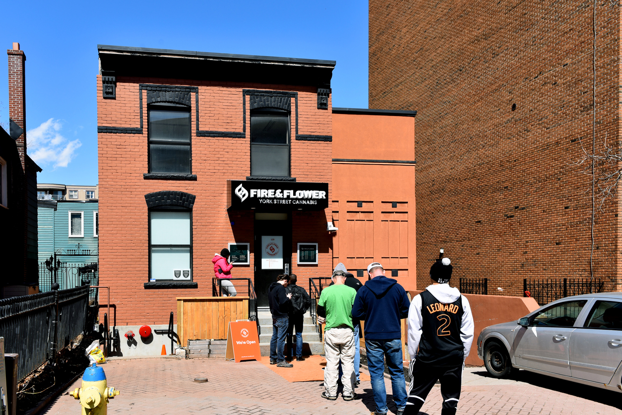 Ottawa, Canada - April 13, 2019: Customers wait in line to enter the Fire & Flower Cannabis store on York St in the Byward Market. The store opened April 1 the first day for legal retail store sale of cannabis in Ontario. Retail store sales of cannabis was legalized in Canada Oct 17, 2018 but not until April in Ontario.