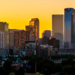 Orange Glow Sunrise in the Mile High City - Denver Colorado USA - Close up on Skyline Cityscape growing skyscrapers - golden hour sunrise glowing orange downtown