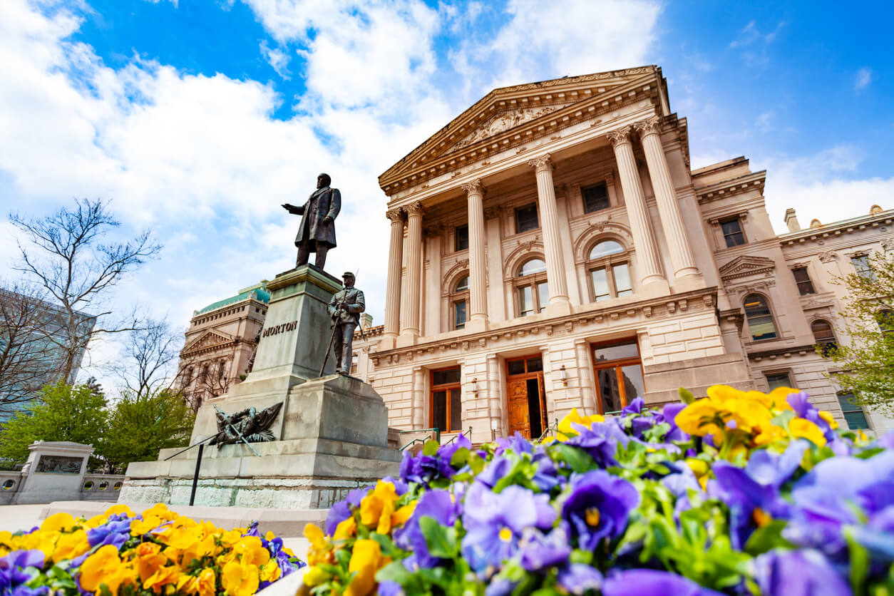 Oliver Perry Morton statue in front of the Indiana State Capitol building in springtime, Indianapolis, USA