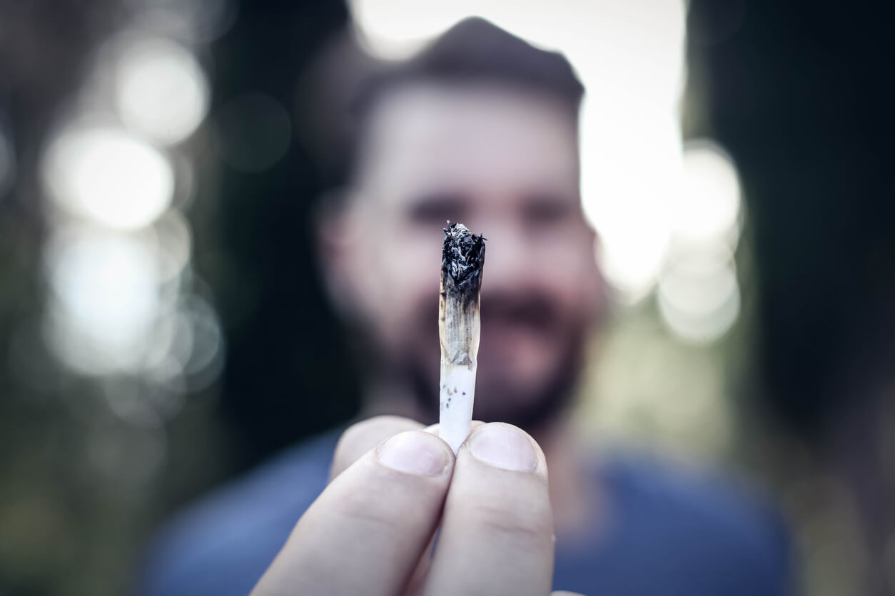 Man holding joint