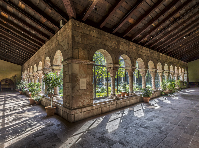 New York, United States - October 22, 2015: Colonnade and garden at The Cloisters, the branch of The Metropolitan Museum of Art devoted to the art and architecture of medieval Europe.