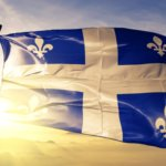 Quebec flag blowing in the wind.
