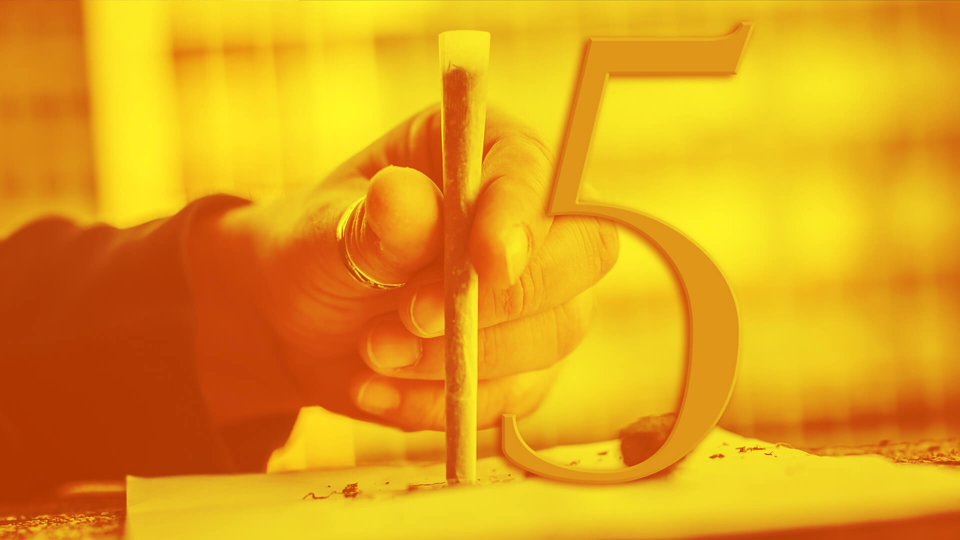 Man holding up joint to create the number 15.