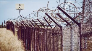 a barbed wire fence in California