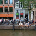 People visit a coffee shop in Amsterdam, Netherlands. Coffeeshops legally sell marijuana for personal consumption.
