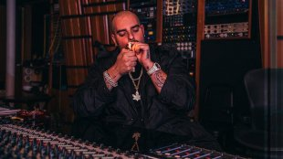 Rapper Berner lighting a joint in a recording studio