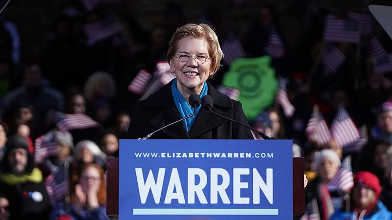 Elizabeth Warren smiles while talking to crowd