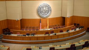 Empty House of Representatives chamber within the New Mexico State Capitol in Santa Fe.