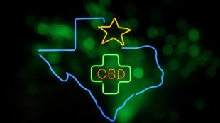 LED sign of the State of Texas with CBD sign in the middle