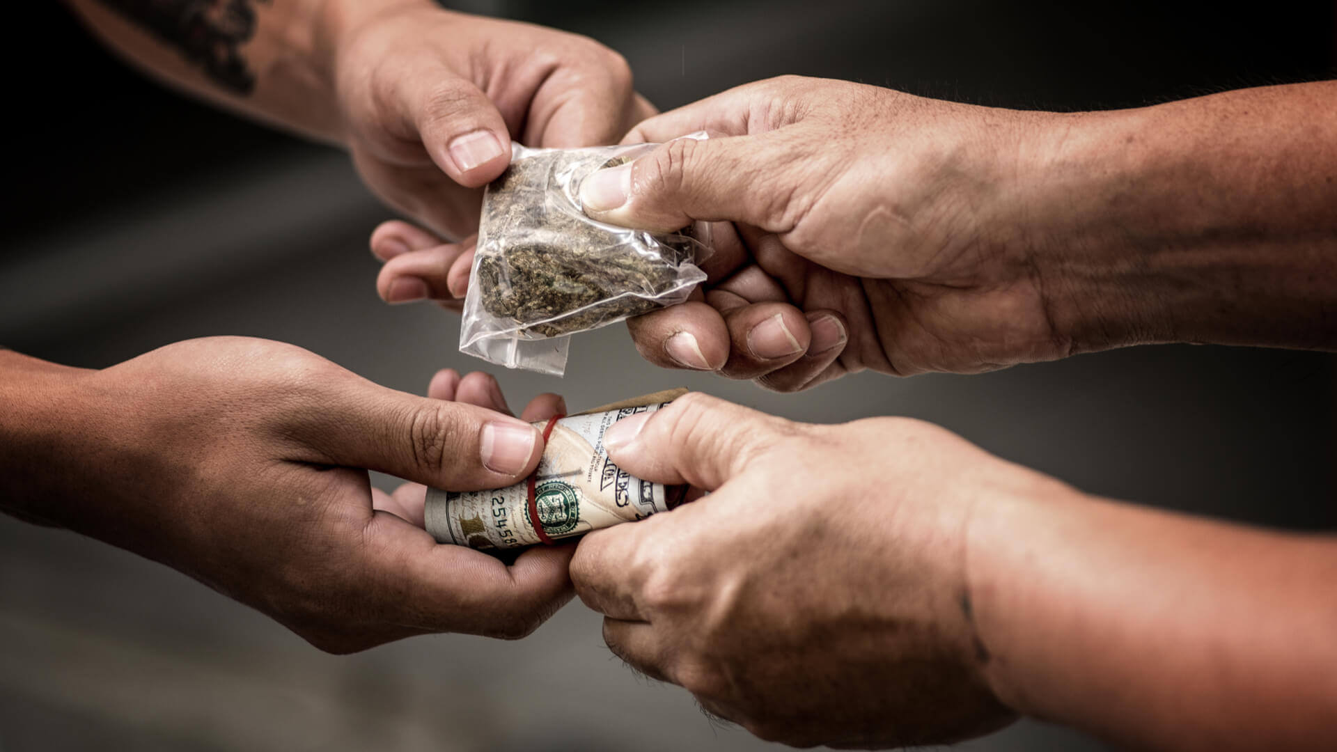 Cannabis and money exchange hands in a deal