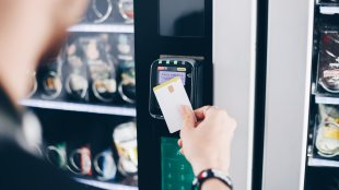 Man Using Card on Contactless Vending Machine